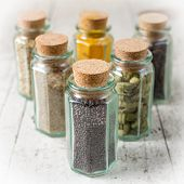 Idian Spices In A Glass Jars Isolated