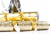 Closeup Of Christmas Crackers And Champagne Bottle