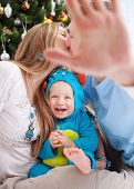 image of hand kiss  - Young parents cover camera with hand while kissing - JPG