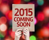 2015 Coming Soon written on colorful background with defocused lights