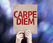 Carpe Diem card written on colorful background with defocused lights