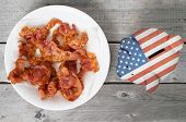 Bring Home The Bacon Concept Piggy Bank Overlaid With American Flag Against Wooden Background