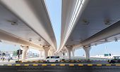 Cars Drive On The Highway Under Automotive Bridges