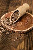 Flax Seeds In Wooden Scoop