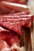 meat antipasti Platter of Cured Meat,   jamon, olives, sausage, salami  on old wooden board