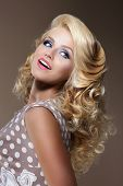 Happy Woman With Frizzy Blond Hairs Looking Up