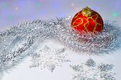 Christmas ball, tinsel and snowflakes