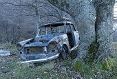 old car , scrap iron , abandoned