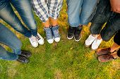 stock photo of short legs  - Legs and sneakers of teenage boys and girls - JPG