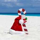Santa Claus Hat And Cane At Caribbean Sandy Beach, Cancun