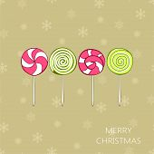 Christmas vintage card with lollipops. Vector