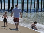 Father and Sons Beachcombing