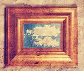 foto of dingy  - a distressed frame with a cloud in it toned with a retro vintage instagram filter  - JPG