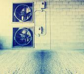 old interior with brick wall with fans toned with a retro vintage instagram filter