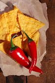 picture of nachos  - Tasty nachos and chili pepper on paper - JPG