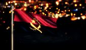 Angola National Flag City Light Night Bokeh Background 3D