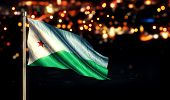 Djibouti National Flag City Light Night Bokeh Background 3D