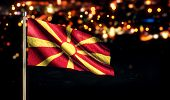 Republic Of Macedonia National Flag City Light Night Bokeh Background 3D