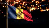 Moldova National Flag City Light Night Bokeh Background 3D