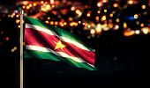 Suriname National Flag City Light Night Bokeh Background 3D