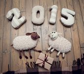 Toy sheep and 2015 handmade wooden background