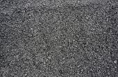 The texture of fresh asphalt lined close up. Pavement surface top view background
