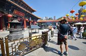 Tourist Takes A Photo Of Chinese Temple In Hong Kong