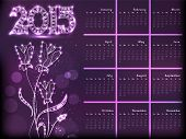 2015 year calendar, decorated with beautiful floral design on purple background.
