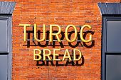 Turog Bread sign on wall.