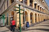 Tourists Visit Historical Buildings Surround The Leal Senado Squarein Macau
