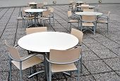 stock photo of anteroom  - modern bar tables and chairs made of plastic and aluminum floor rocks - JPG