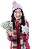 Girl With Piggybank And Dollar Bills