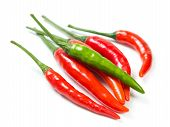 stock photo of red hot chilli peppers  - Red hot chilli peppers isolated on white background - JPG