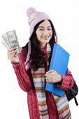 Student In Winter Clothes Holds Money