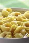 Tortellini in a white bowl