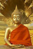 Buddha statue in red at Wat Boromthat Tak Thailand.