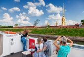 Tourists At The Excursion Boats Look On Peter And Paul Fortress In A Sunny Summer Day