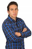 young handsome man wearing a blue plaid shirt posing
