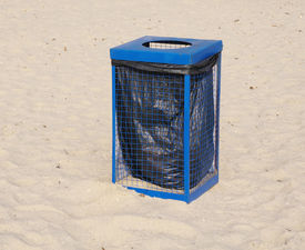 image of dustbin  - Metal blue garbage dustbin on beach sand in sunny day - JPG