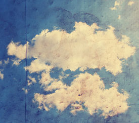 image of ozone layer  -  paper texture background with clouds toned with a retro vintage instagram filter  - JPG