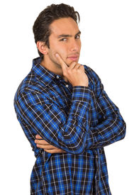 stock photo of flirty  - handsome young happy flirty latin man wearing a blue plaid shirt posing with hand on cheek isolated on white - JPG