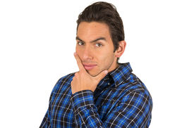 picture of flirty  - handsome young flirty latin man wearing a blue plaid shirt posing with hand on chin isolated on white - JPG