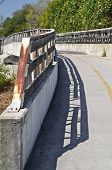 image of bike path  - The rail of a curved bike path casts it