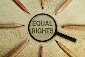 picture of racial discrimination  - Text under a magnifier in a conceptual image as appeal to respect human rights - JPG