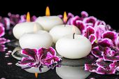 picture of geranium  - beautiful spa concept of geranium flower beads and candles in reflection water closeup - JPG