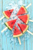 stock photo of popsicle  - watermelon popsicle yummy fresh summer fruit sweet dessert on vintage old wood teak blue - JPG