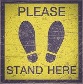 foto of slip hazard  - PLEASE STAND HERE foot sign or symbol on the floor Retro filter effect - JPG