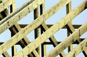 foto of rafters  - Wooden rafters on top of new house - JPG
