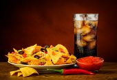 stock photo of nachos  - still life with nachos plate salsa dip and cola drink - JPG