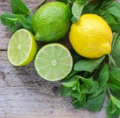 image of mint-green  - Juicy ripe citrus on an old wooden table  - JPG